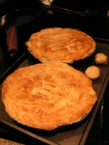 two pot pies with pastry biscuits